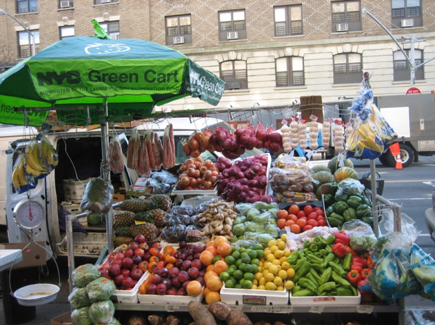 An NYC Green Cart and its supply of fresh produce. Photo courtesy NYC Health Department.
